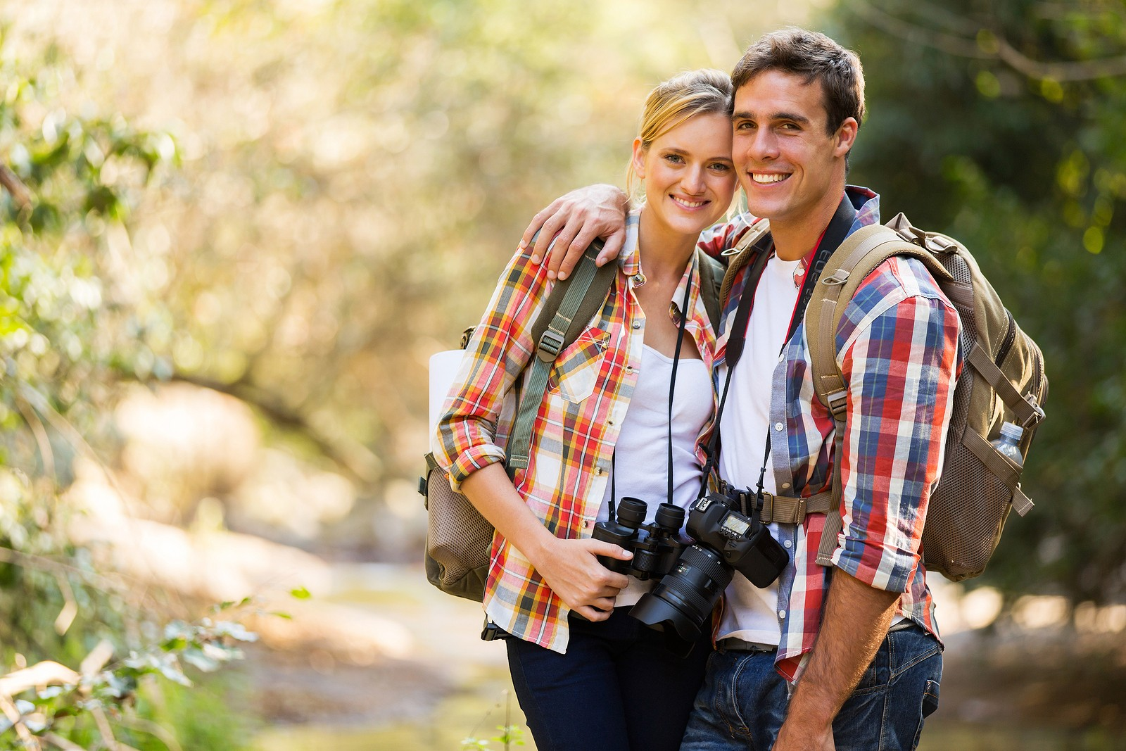 happy young couple hiking in mountain
